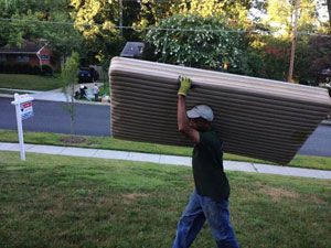 Junk Removal: Carrying Desk Top Into Large Truck