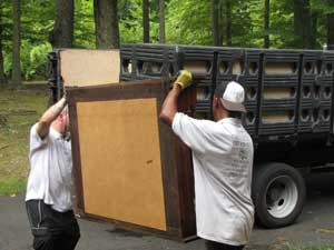 Junk-removal-carrying-desk-top-into-larg