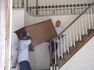 Junk Removal: Carrying Furniture Down the Stairs